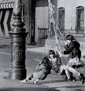 Three-girls-spin-around-a-lamp-post-Small